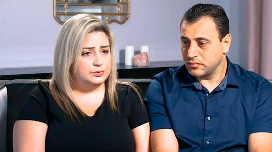 Anni, left, and Ashot Manukyan describe their lawsuit against a fertility clinic during an interview in Los Angeles.