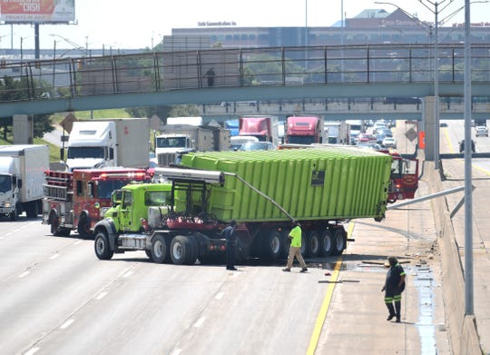 A GFL Environmental waste truck is part of a crash limiting traffic on I-75  to one lane in Detroit on July 10, 2019.
