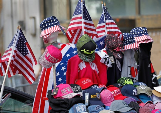 "Flag-themed souvenirs are for sale on Broadway, also known as the ""Canyon of Heroes,"" along the parade route in lower Manhattan, one day ahead of a ticker-tape parade and City Hall ceremony for the four-time World Cup winning U.S. women's soccer team, Tuesday, July 9, 2019, in New York."