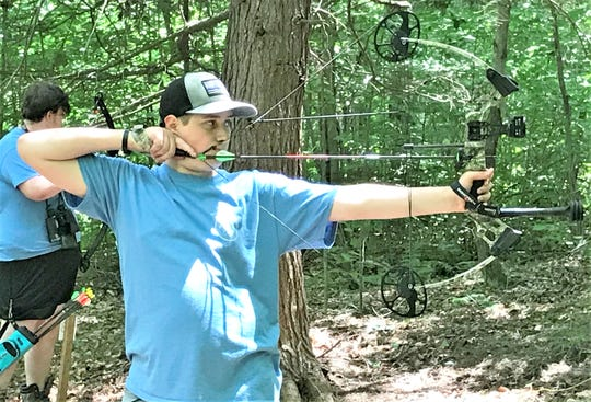 Riley Cowl of the New York team takes aim at an archery target Wednesday during the NRA Youth Hunter Education Challenge Eastern Regional Championship at the Chemung County Rod and Gun Club.