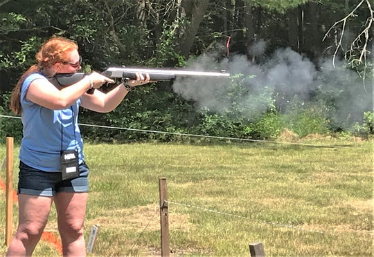 Abby Vaughn, a shooter from North Carolina, fires a muzzleloading rifle at a target Wednesday during opening day of the NRA Youth Hunter Education Challenge Eastern Regional Championship at the Chemung County Rod and Gun Club in Breesport.