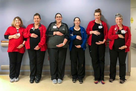 Emily Milligan, from left, Megan Septer, Lauren Williams, Tiffany Goldman, Kim Dahlen and Tyler Greenwell are employees of The Heart Hospital at Deaconess Gateway in Newburgh. They are all pregnant and expecting boys with due dates ranging between mid-July through the end of September.