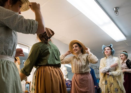 "A group of ""Lovely Ladies"" adjust their hats before leaving the dressing room for a dress rehearsal of the Public Education Foundation's Summer Musical, Les Misérables. The play opens this week with a new set and lots of talented students from around the tri-state Tuesday, July 9, 2019."