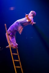 "The ladder act in ""Cirque du Soleil: Corteo"" features acrobats balancing on ladders high above the stage."