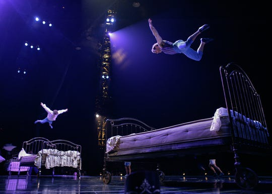 "Acrobats jump up and down on oversized beds in the Bouncing Beds act from ""Corteo."""