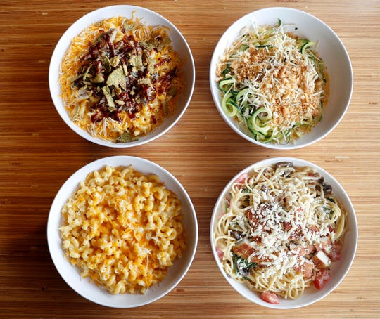 Sartori cheese is a key ingredient in some of Noodles & Company's popular dishes including (from left to right) BBQ Pork Mac, Zucchini Truffle Mac, Wisconsin Mac & Cheese, and MontAmore Alfredo with Parmesan-Crusted Chicken.