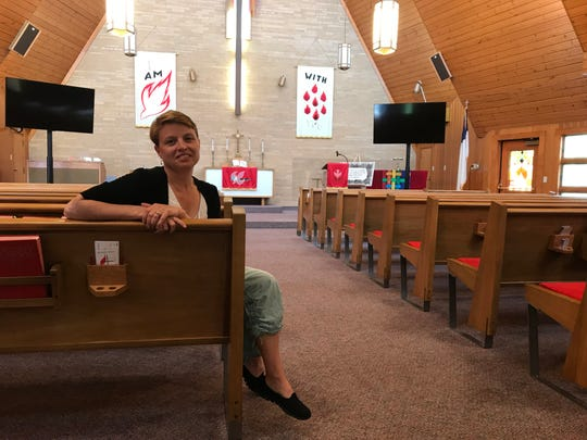 Rev. Jennifer Emert, pastor for Algoma and West Kewaunee United Methodist churches, inside the Algoma church. Emert and the local churches are taking a stand against global church rules they say discriminate against LGBTQ members and clergy persons.