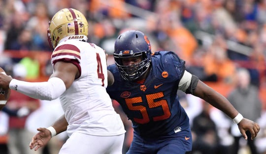 Nov 25, 2017; Syracuse, NY, USA; Syracuse Orange defensive lineman Kendall Coleman (55) applies pressure on Boston College Eagles quarterback Darius Wade (4) during the third quarter of a game at the Carrier Dome. Mandatory Credit: Mark Konezny-USA TODAY Sports