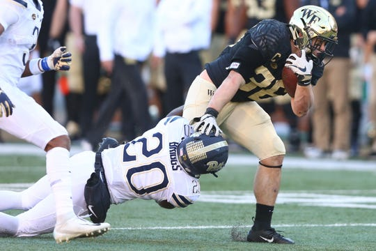 Nov 17, 2018; Winston-Salem, NC, USA; Wake Forest Demon Deacons running back Cade Carney (36) drags Pittsburgh Panthers defensive back Dennis Briggs (20) during the third quarter at BB&T Field. Mandatory Credit: Jeremy Brevard-USA TODAY Sports
