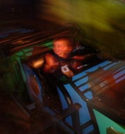 Asa Connor rides a miniature roller coaster in the Pavilion Amusement Park in July 2006.