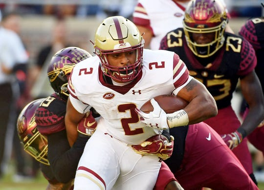 Nov 17, 2018; Tallahassee, FL, USA; Boston College Eagles running back AJ Dillon (2) runs the ball as Florida State Seminoles defensive back AJ Westbrook (19) wraps him up during the first half at Doak Campbell Stadium. Mandatory Credit: Melina Myers-USA TODAY Sports