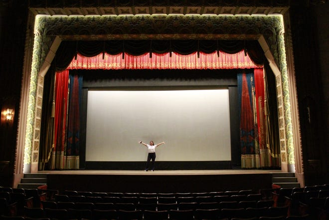 Enya Spicer on the stage of the Washoe Theatre
