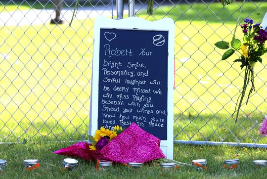 The school district in Hamilton encourages people to bring flowers, pictures and letters to the memorial.