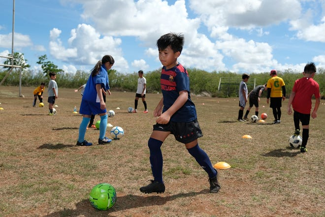 Youths hone their skills at the University of Guam Triton Athletics' Advance Co-Ed Boys and Girls Soccer Camp.