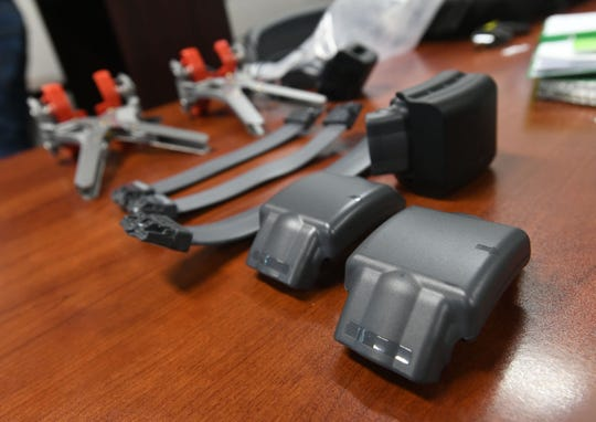 Buddi Smart Tag electronic monitoring devices and accompanying accessories are displayed on a table as Superior Court of Guam probation officers attend a training session on implementation and use at the Judicial Education Center in Hågatña July 10.