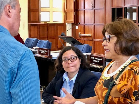 Former Speaker Judi Won Pat, right, now the chief academic officer for Guahan Academy Charter School, speaks to Sen. James Moylan, left, and Sen. Sabina Perez, center, right before the session resumed on July 10, 2019 wherein senators debated bills related to charter schools.