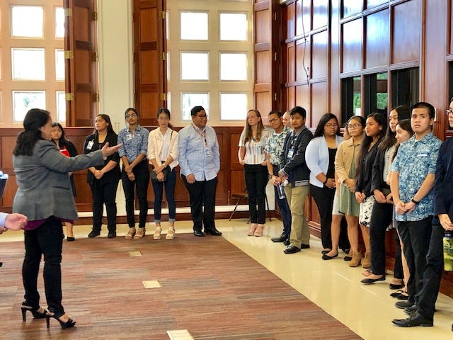 Speaker Tina Muña Barnes, left, welcomes interns from the Public Policy Institute and visiting interns from the District Court of Guam , right before the legislative session resumed on July 10, 2019. The interns watched the session, where senators debated bills related to charter schools.