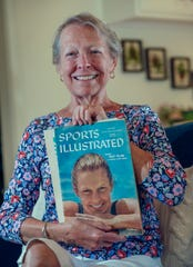 Becky Collins, now Becky Furste, poses with her cover.