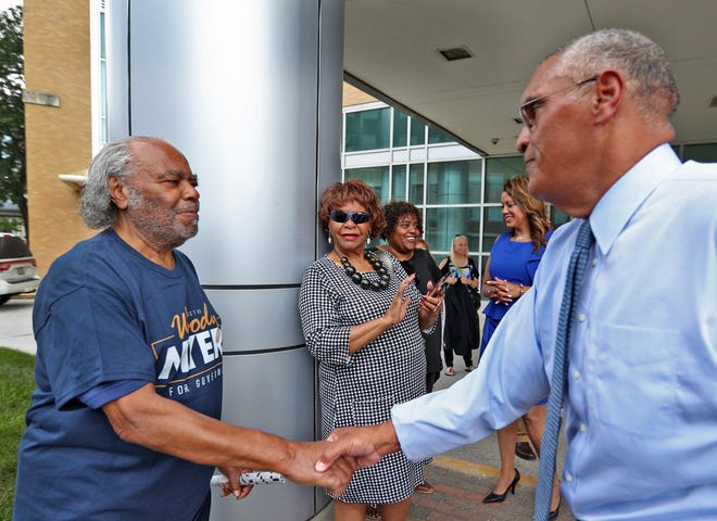 Woody Myers (right) shakes hands with one of his uncles, Herschel Tyler, after a press conference announcing Myers' bid for governor on Wednesday, July 10, 2019, at the old Wishard Emergency Department.