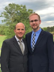 Joshua Payne-Elliott (right), pictured with his husband Layton Payne-Elliott, is suing the Archdiocese of Indianapolis.