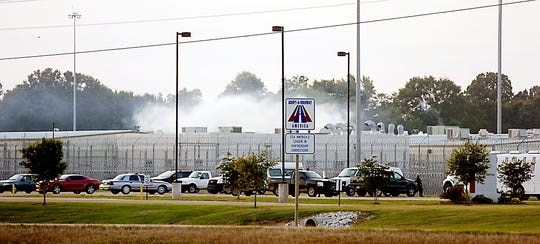Smoke rises above the Adams County Correctional Center in Natchez, Miss., on May 20, 2012, during an inmate disturbance at the prison.