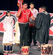 Cyrus Ben, second from left, stands with family members as he takes the ceremonial oath of office as the newly-elected chief of the Mississippi Band of Choctaw Indians, Tuesday, July 9, 2019.