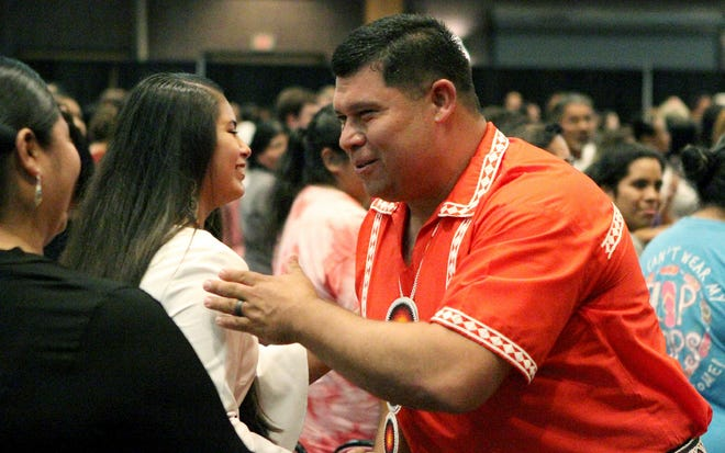 Cyrus Ben, right, is congratulated by tribal members after taking the ceremonial oath of office as the newly-elected chief of the Mississippi Band of Choctaw Indians, Tuesday, July 9, 2019, at the Silver Star Hotel and Casino Convention Center in Philadelphia, Miss.