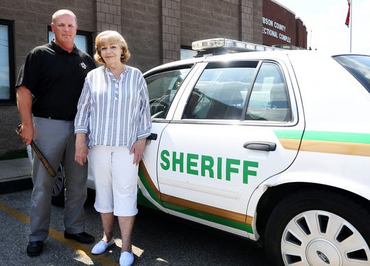Gibson County Sheriff Paul Thomas stands with his mother, Donna, outside the Gibson County Correctional Complex in Trenton. Thomas holds in his hand a club used by his grandfather, James Patrick Trainor, who was a police officer in Massachusetts. Thomas grandfather died on duty.