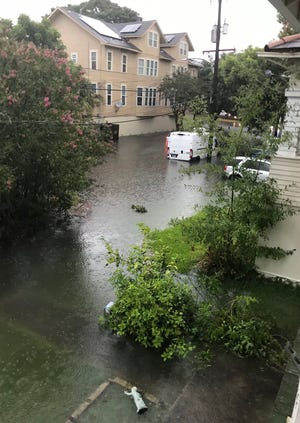 In this photo made available by Conway, a street in New Orleans is flooded by heavy rain, Wednesday, July 10, 2019.