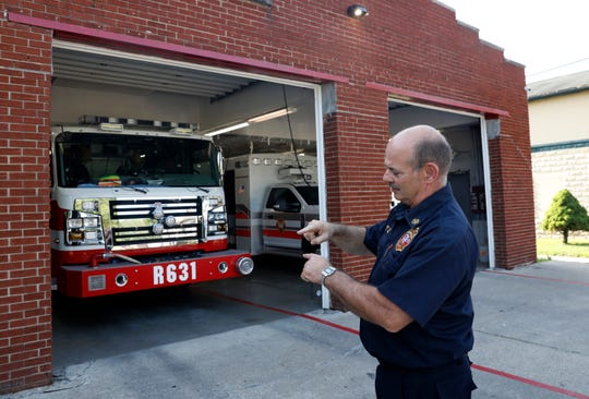 Millersport Fire Chief Bob Price talks about how little clearance there is between the department's rescue truck and the station's roll-up door Tuesday, July 9, 2019, in Millersport. The department had the truck specially built to fit into the current station. The village hopes to being construction of a new, larger station later this month.