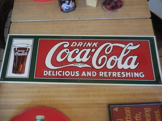 A Coca-Cola sign that once hung in Coney Joe's is one of many items in an online auction, following the restaurant's closure.