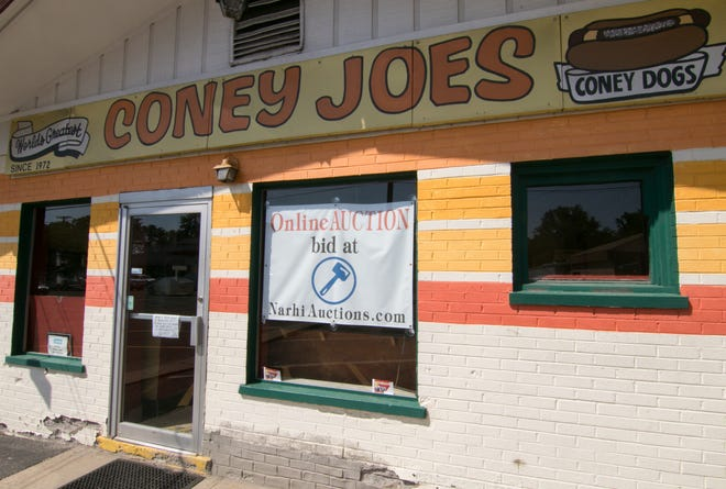 Signs, memorabilia and kitchen equipment at Brighton's closed iconic eatery Coney Joe's, shown Wednesday, July 10, 2019, will go up for online auction Thursday through Monday.