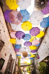 Colorful umbrellas provide the shade in the outdoor courtyard of the Red Tree furniture store at 701 E. Market St. in NuLu. July 8, 2019