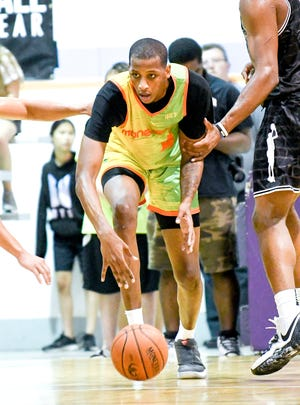 Michigan State's Marcus Bingham Jr. steals the ball during a Moneyball Pro-Am game on Tuesday, July, 9, 2019, at Aim High Sports in Dimondale.