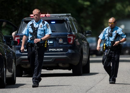 Members of the Lansing Police Department leave the scene of a standoff July 10, 2019, in north Lansing after a standoff.  One officer was taken to the hospital with serious but non-life-threatening injuries.  After about one hour of with police negotiaters, three people surrendered and were taken into custody.