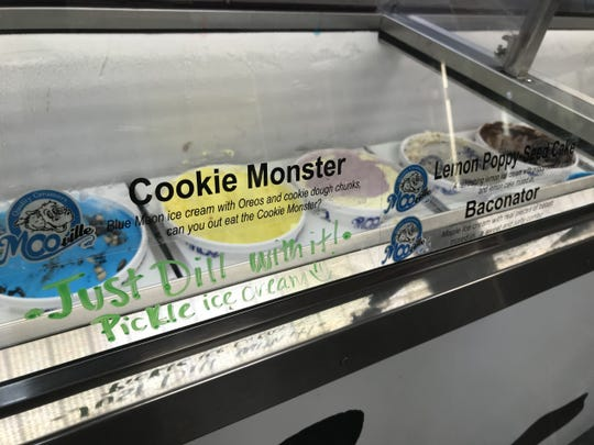 """Ice cream flavors behind the front counter at MOO-ville Creamery in Nashville include """"Just Dill With It,"""" a pickle ice cream, and """"Baconator,"""" a maple ice cream with bacon pieces."""