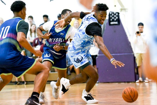Michigan State's Julius Marble, right, moves past Cassius Winston during a Moneyball Pro-Am game on Tuesday, July, 9, 2019, at Aim High Sports in Dimondale.