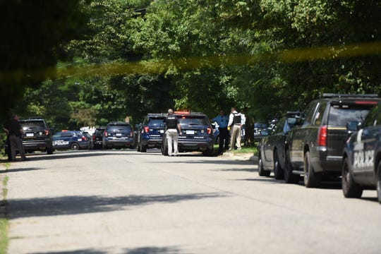 Police were staged outside a home on Lansing's north side on Wednesday afternoon.