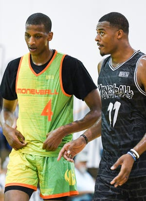 Michigan State's Xavier Tillman, right, talks with fellow Spartan Marcus Bingham Jr. during a Moneyball Pro-Am game on Tuesday, July, 9, 2019, at Aim High Sports in Dimondale.