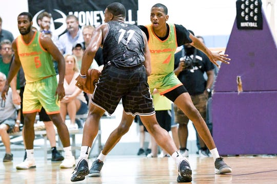 Michigan State's Marcus Bingham Jr., right, guards fellow Spartan Xavier Tillman during a Moneyball Pro-Am game on Tuesday, July, 9, 2019, at Aim High Sports in Dimondale.