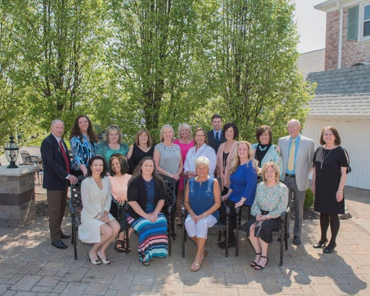 From left, front, Tracy Dickerson, Ruth Ann Etzinger, Waynette Chase, Karen Riegel, Diana Bowman, Joan Caudle; and back, Bix Sluss, Sandy Capra, Bobbi Buzzard, Sheila Sipes-Jones, Lori Amicone, Annette Depue, Dawn Geary, Grant Sluss, Sandy Thompson, Kim Thompson-Barley, Roger Heston and Erika Young.