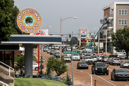 Midtown Donuts at 1776 Union, left, as well as the Citizen apartments at 1835 Union, right, as afternoon traffic moves along, July 10, 2019.