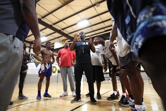 Coach Norton Hurd leads Team Thad, his Under Armour sponsored AAU team, from the Memphis Elite Allstars court in Cordova on Tuesday, July 9, 2019.