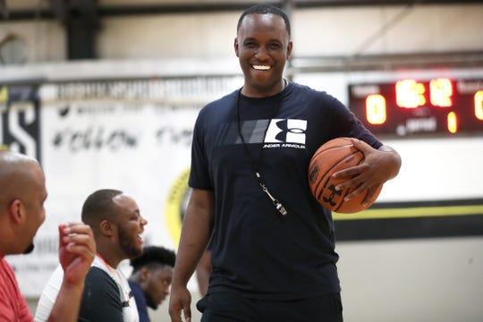 Coach Norton Hurd shares a laugh with his fellow coaches and players for Team Thad, his Under Armour sponsored AAU team, during their practice at  Memphis Elite Allstars court in Cordova on Tuesday, July 9, 2019.