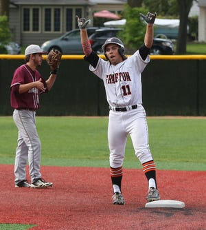 Grafton's Bryce Fisk celebrates a double as he tries to rally his team in the seventh inning during a sectional final game against Menomonee Falls in 2015 at Cahill Park in Whitefish Bay. The Grafton baseball and softball teams will play on a turf field just like Cahill Park in 2020.