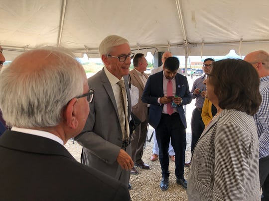Gov. Tony Evers chats with guests before a news conference Wednesday in Pleasant Prairie. Nexus Pharmaceuticals announced plans to build a new factory in the village.
