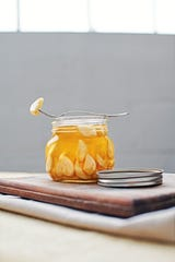 Garlic fermented in honey is an unusual savory condiment that works with everything from grilled meats to stir-fries.