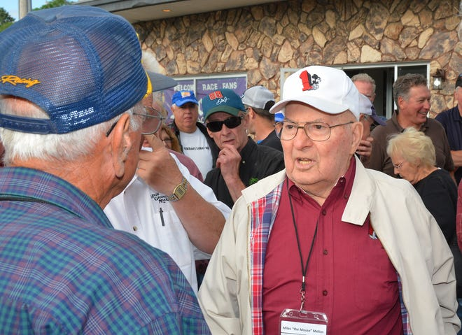 """Miles """"The Mouse"""" Melius (right) chats with retired NASCAR driver Dave Marcis at a gathering in Wausau in 2016."""