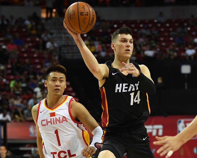 Jul 5, 2019; Las Vegas, NV, USA; Miami Heat guard Tyler Herro (14) makes a pass away from Chinese National Team guard Rui Zhao (1) during the first half of an NBA Summer League game at Thomas & Mack Center. Mandatory Credit: Stephen R. Sylvanie-USA TODAY Sports