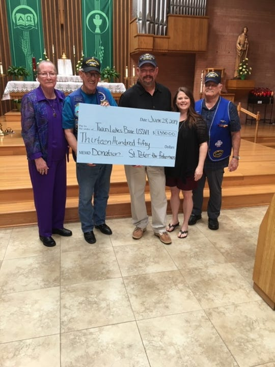 St. Peter the Fisherman Catholic church in Mountain Home recently donated $1,350 to the Twin Lakes Base of the USSVI to help with feeding and clothing local veterans. Pictured are: (from left) Priscilla Grant, Assistant Member; Curtis Grant, Past Base Commander and Chaplin; Mike Davenport, Base Commander; Brandi Noval, Director of Youth Ministry at St. Peter's; and Thomas Hanby, Treasurer.